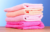 Few towels on blue background — Stock Photo