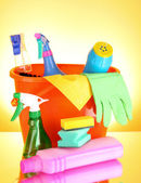 Cleaning supplies on red background — Stock Photo