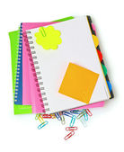 Bright notebooks and paper clip — Stock Photo