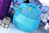 Bright blue yarn, fabric, satin ribbon and measuring tape — Stock Photo