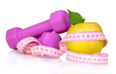 Towel, apple with measure tape, dumbbells isolated on white — Stock Photo