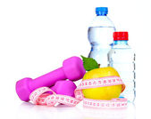 Towel, apple with measure tape, dumbbells and water bottle isola — Stock Photo