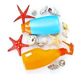 Sunblock in bottles and shells isolated on white — Stock Photo