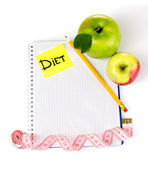 Planning of a diet. Notebook, pencil and fresh apples isolated on white — Stock Photo