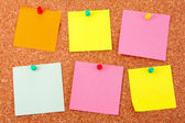 Six colorful stickers pinned to a cork board — Stock Photo