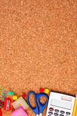 Stationery on cork board — Stock Photo