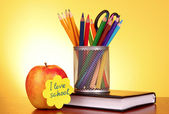 """Stationery and apple with """"I love school"""" on yellow background — Stock fotografie"""