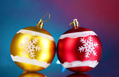 Beautiful Christmas balls on blue background — Stok fotoğraf