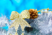 Beautiful cones, bow and tinsel — Stock Photo