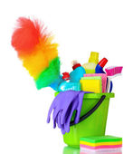 Detergent bottles, brushes and gloves in bucket — Stock Photo