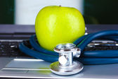 Medical stethoscope, apple and notebook — Stock Photo