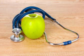 Medical stethoscope and apple — Photo