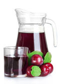 Pitcher and glass of compote and plums — Stock Photo