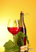Red wine on yellow background — Stockfoto