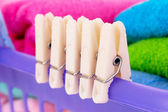 Clothespins closeup on cloth basket — Stock Photo