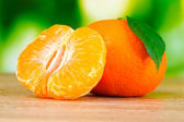 Juicy ripe tangerines with cloves — Stock Photo