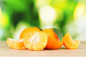 Juicy ripe tangerines with cloves — Stockfoto