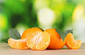 Juicy ripe tangerines with cloves — Stok fotoğraf