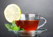 Tea with lemon and mint — Stock Photo