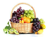 Ripe juicy fruits in basket — Stock Photo