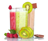Delicious fruit smoothies and fruits — Stock Photo