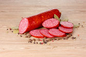 Tasty sausage and spices — Stock Photo