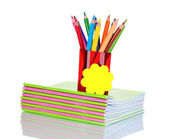 Pencils in holder and notebooks — Stock Photo