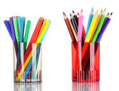 Bright markers and crayons in holders — Stock Photo
