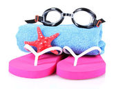 Glasses for swimming, towel and beach shoes — Stock Photo