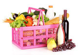 Vegetables and wine in a basket — Stock Photo