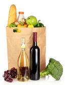 Paper bag with vegetables and food — Stock Photo