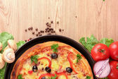 Tasty pizza with olives and vegetables — Stock Photo