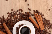 Coffee with cinnamon on wooden texture background — Stock Photo