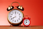 Two Alarm-clocks on red background — Stock Photo