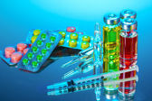 Medical ampoules, pills and a syringe — Stock Photo