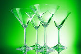 Empty glasses of martini on the green background — Stock Photo