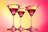 Three martini glasses on red background — Stock Photo