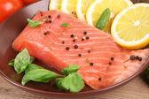 Salmon with lemon and basil — Stock Photo
