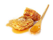 Beautiful combs, spoon and honey — Stock Photo