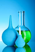 Laboratory glassware on black background — Stock Photo