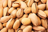 Pistachios nuts background — Stock Photo