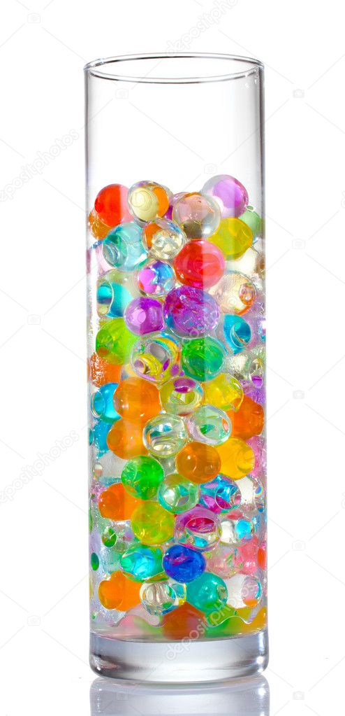 Color balls in glass vase isolated on white — Stock Photo #6790952