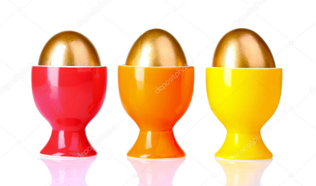 Golden eggs in bright stands isolated on white — Stock Photo #6791188