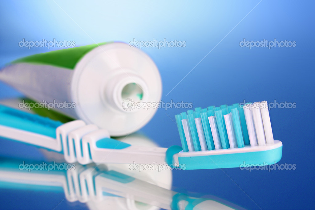 Toothpaste and brush on a blue background  Stock Photo #6792392