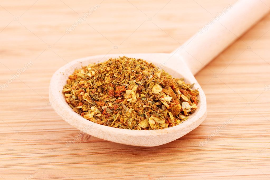 Spices in spoon on wooden table — Stock Photo #6792428