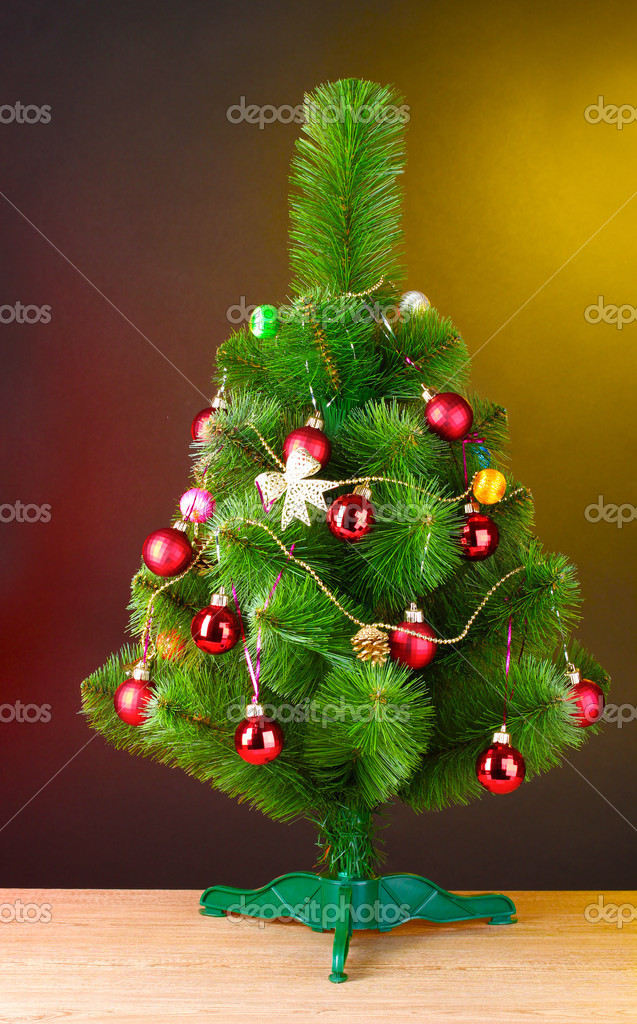 Beautiful Christmas tree on wooden table  Stock Photo #6794235