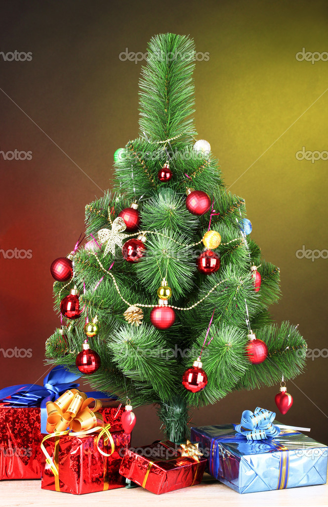Beautiful Christmas tree and gifts on wooden table — Stock Photo #6794249