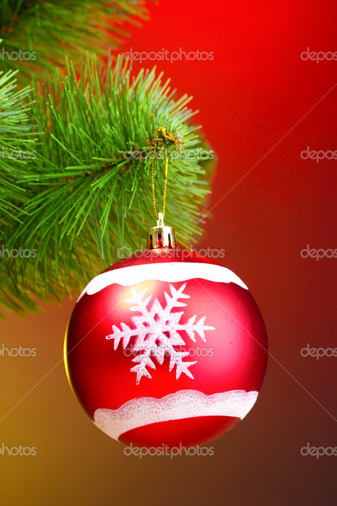 Beautiful Christmas red ball on fir tree — Stock Photo #6794297