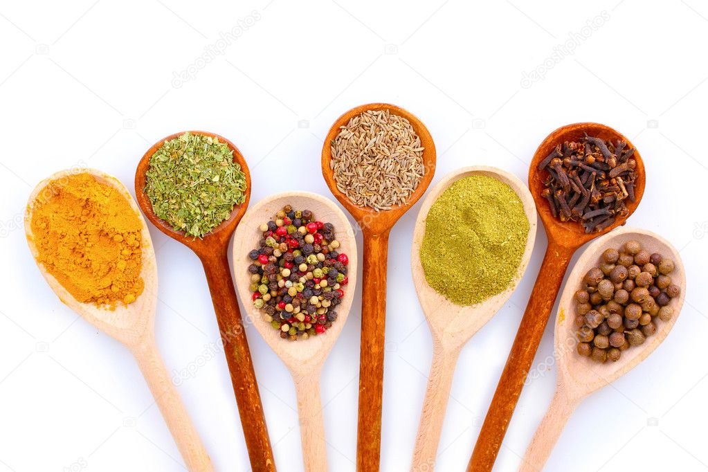 Spices in the spoons isolated on white  Stock Photo #6796463
