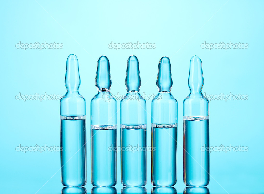 Medical ampoules on blue background — Stock Photo #6798270